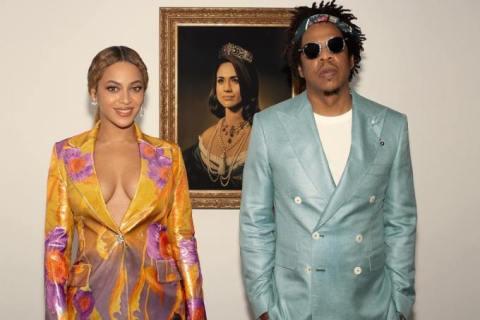 Beyonce e Jay-Z ao lado do quadro da Meghan Markle