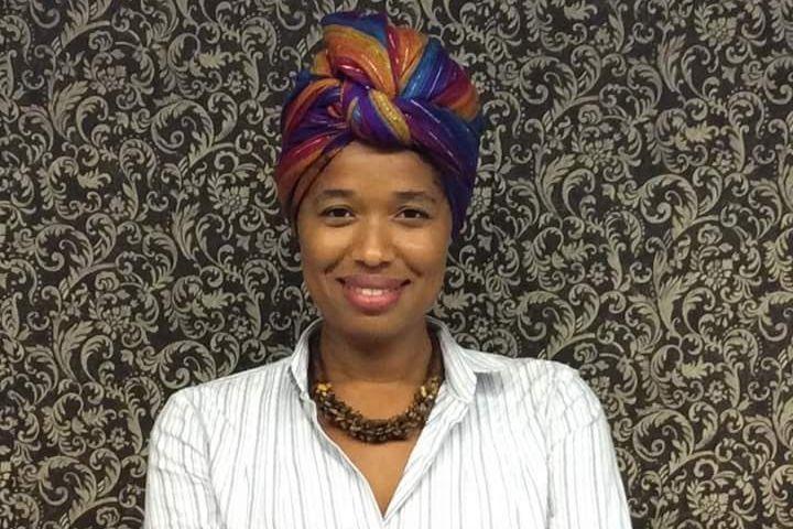 Mirtes uma mulher negra sorrindo