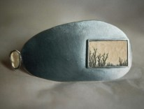 7. (the logos after the tide) slowly. brooch. dentrite stone, mother-of-pearl, oxided silver