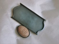 9. (the logos after the tide) frame. brooch. plastic, oxided silver