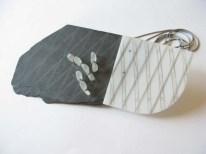 Lake Fortitude 8. Pendant 2011. Slate, acrilyc, glass, horn, brass, thread. 16cm X 13cm X 6cm