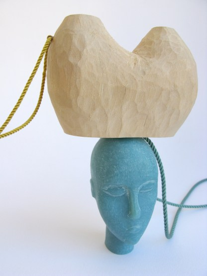 TBP2. Carved reconstructed stone, carved basswood, 9kt gold, silk thread