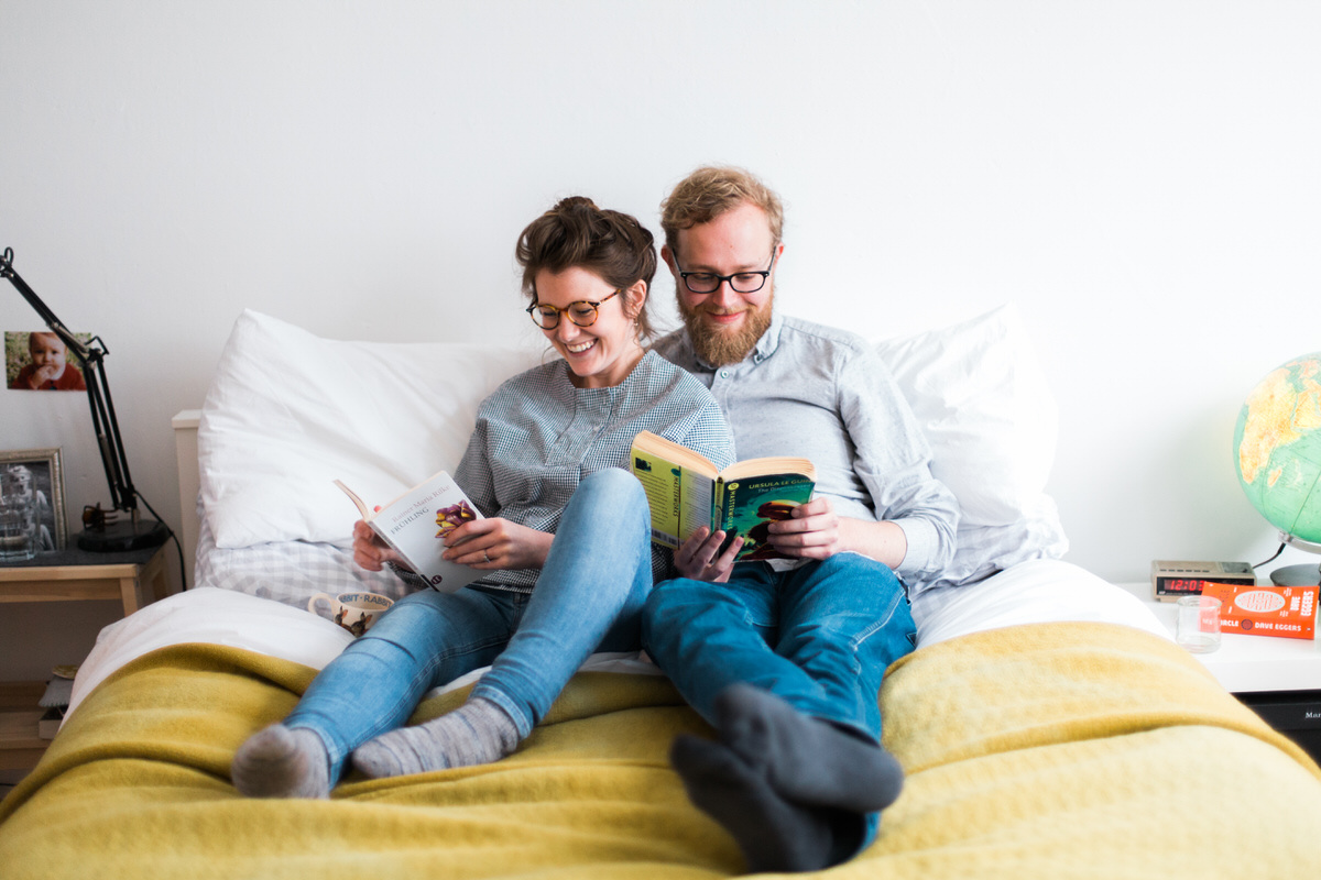 Home engagement shoot, couple reading together