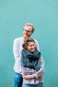 Engagement shoot on a green background