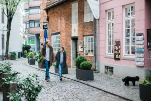 Couple walking Bremen streets in Germany