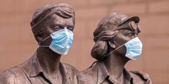 Women of Steel statue wearing masks