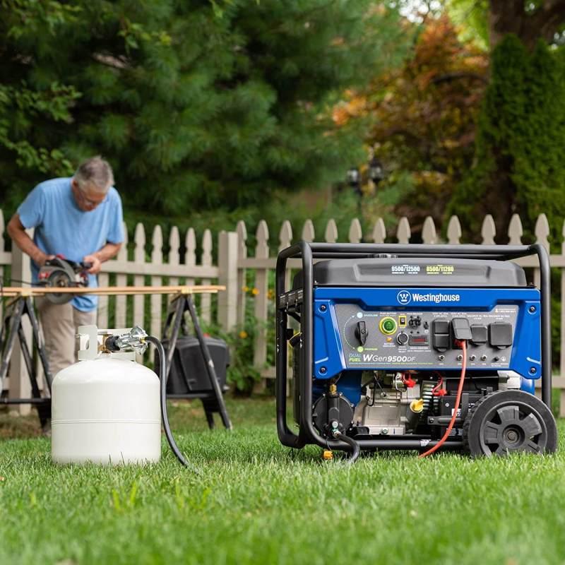A man is using Westinghouse WGen9500DF Dual Fuel Portable Generator-9500