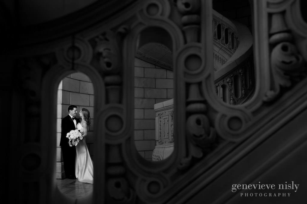 Black and white of the bride and groom in the Old Courthouse staircase.