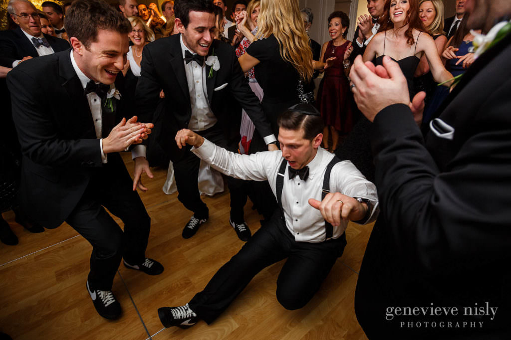 Max dances surrounded by groomsmen during the reception at the Ritz Carlton.