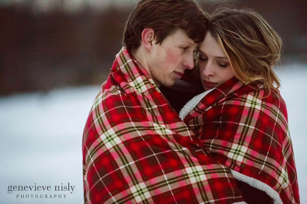 Michael and Jacee snuggle under a blanket during their Boettler Park engagement session.