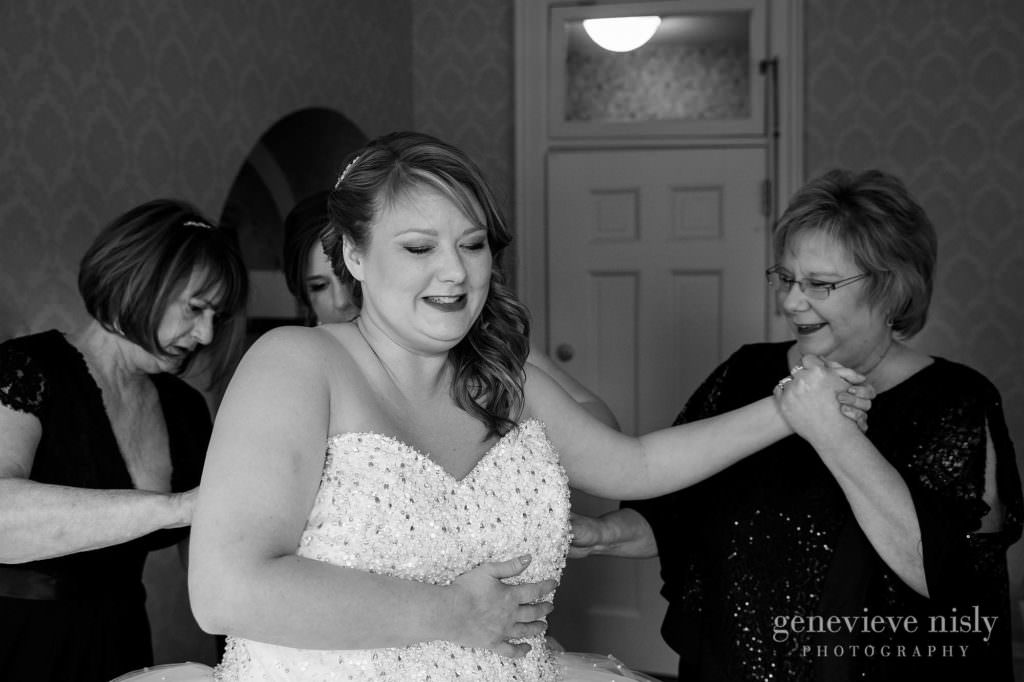 The bride putting her wedding dress on at the Mooreland Mansion.