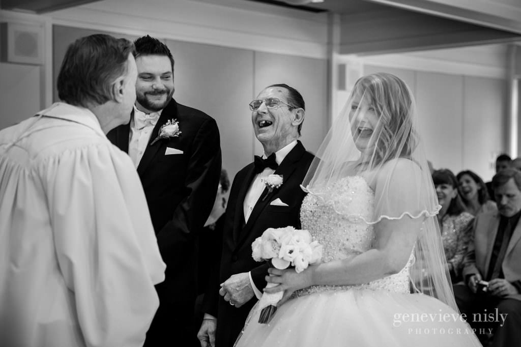 The groom, bride and her dad share a laugh during their wedding ceremony at Mooreland Mansion.