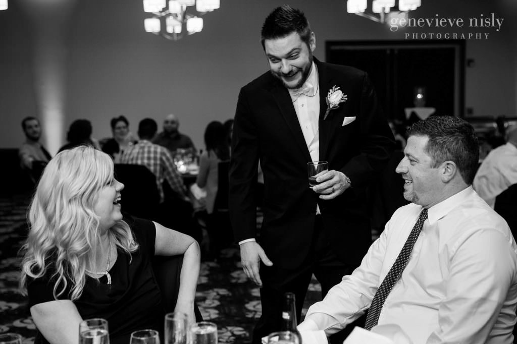 The groom mingles with guests during his wedding reception at the Cleveland Holiday Inn.