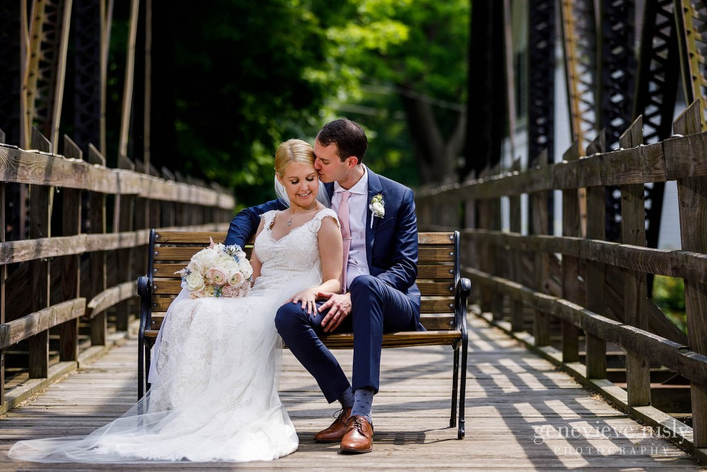 Annie and Luke snuggle each other on the bridge across the street during their Chagrin Valley Hunt Club Wedding in Cleveland Ohio.