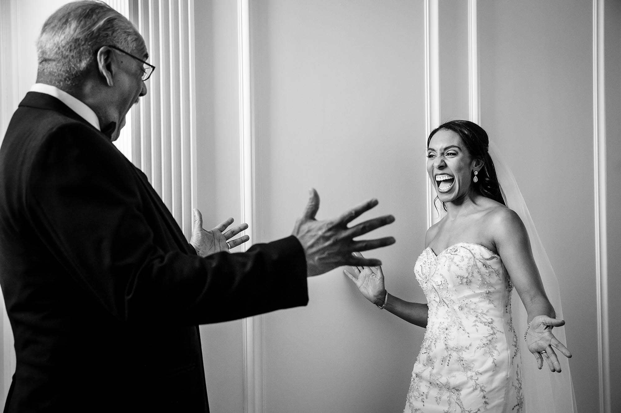 Monique's father sees her in her wedding dress for the very first time on her wedding day just moments before he walks her down the aisle at St. Dominic's Catholic Church in Shaker Heights, Ohio.