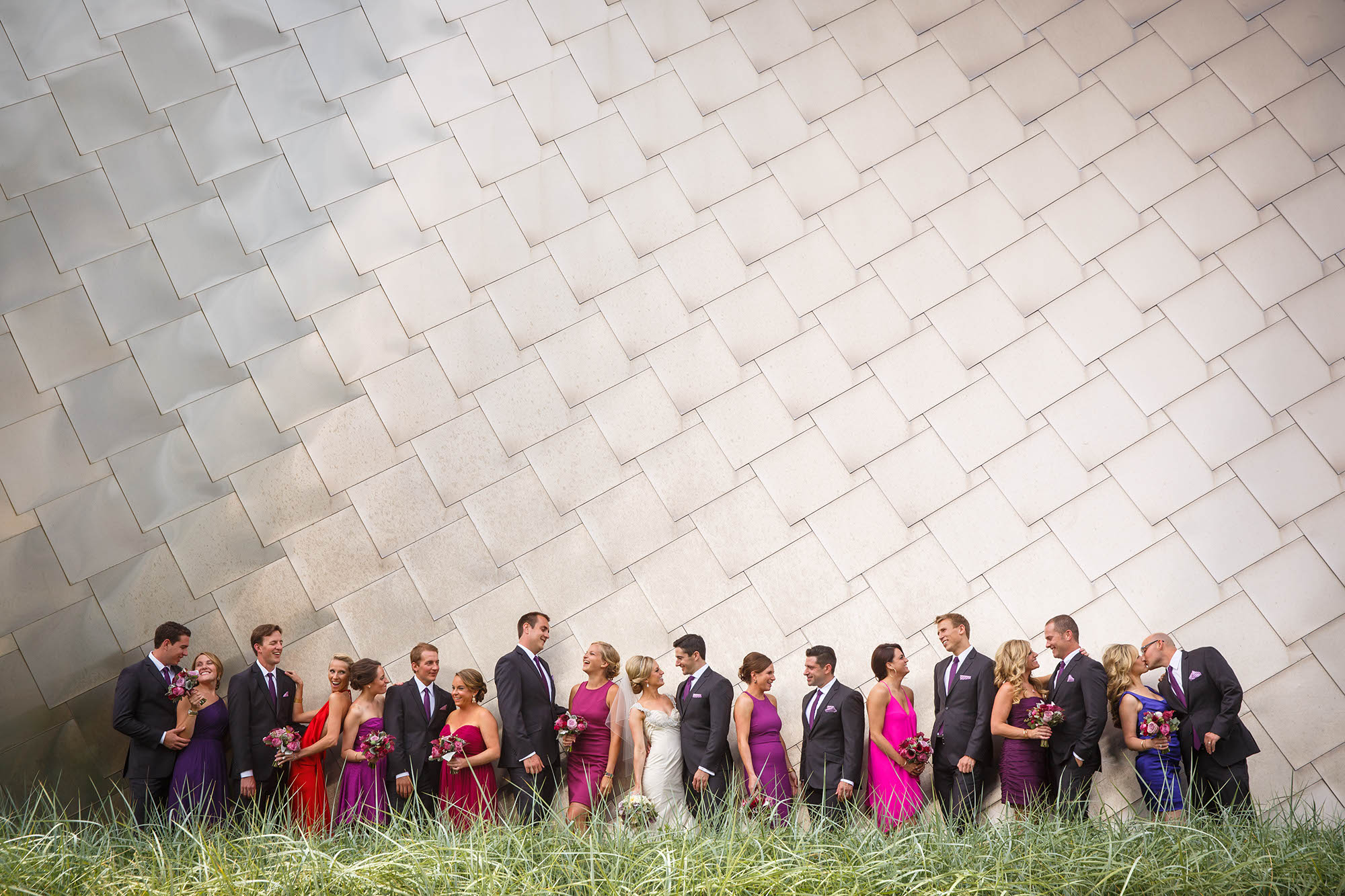 A large bridal party portrait taken in front of the Frank Gehry building on the Case Western University Campus during this Cleveland Museum of Art summer wedding.