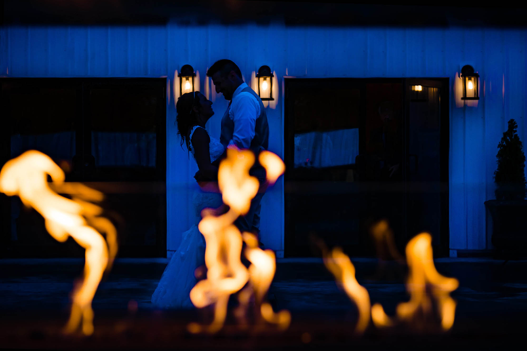 Warm and cool tones for this bride and groom at the end of their reception at Rustic Ridge Wedding Barn New Philadelphia, Ohio.