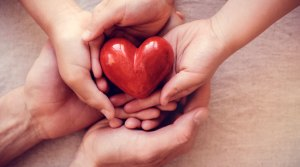 Hands holding heart - Donate Blood for National Blood Donor Month