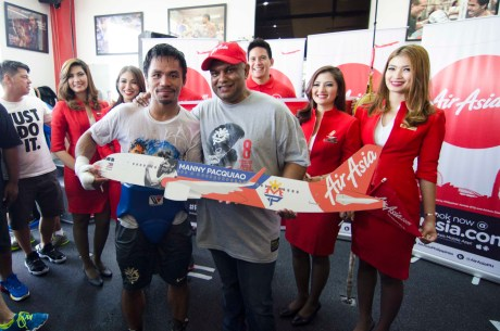 AirAsia Group CEO Tony Fernandes gives Pacman an AirAsia AirbusA320 model plane after the official partnership announcement today, November 12 in General Santos City, Philippines.