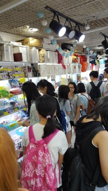 A BUSY KIOSK WITH TEENS