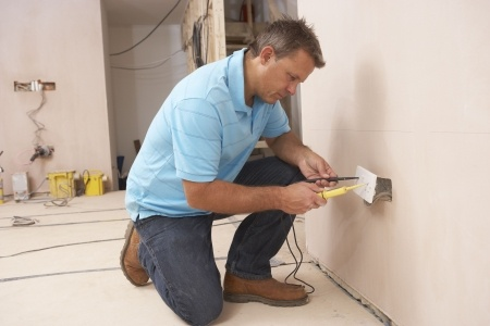 Tracy Electrician installing new wall socket