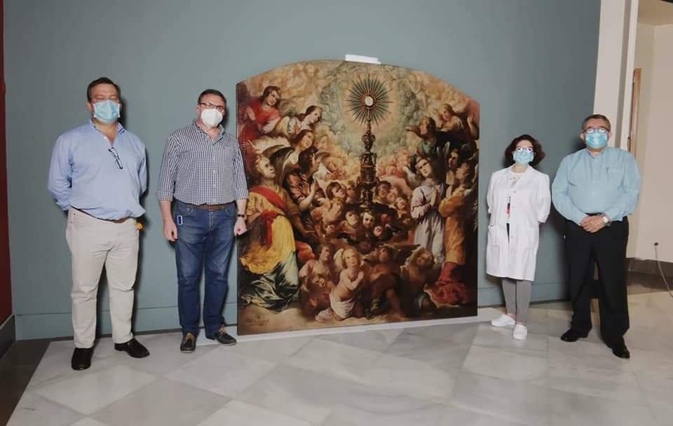 Las Siete Palabras cede temporalmente el cuadro «Exaltación de la Eucaristía» al Museo de Bellas Artes de Sevilla