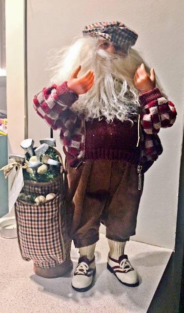 Santa dressed for golf