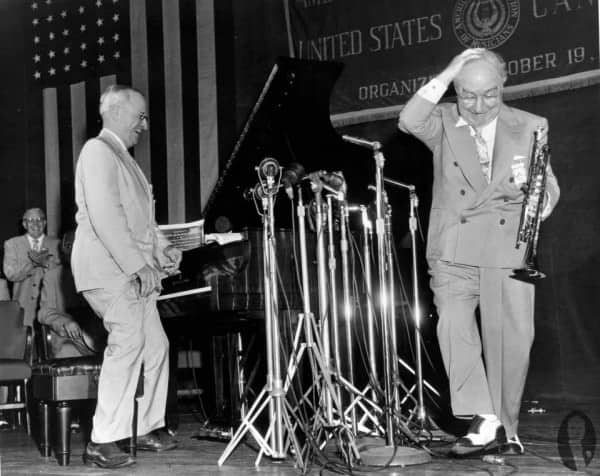 Truman in light colored suit and Oxford shoes