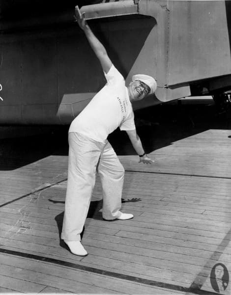 Truman in white shoes aboard a ship