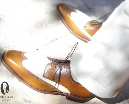 Spectator shoes in brown & white with light colored trousers
