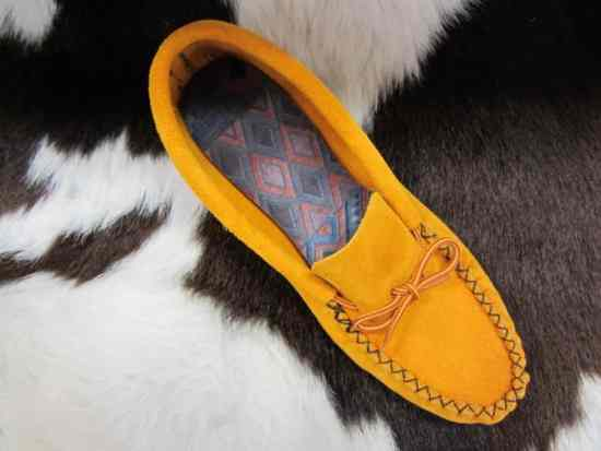 U-shaped uppers on a soft sole moccasin