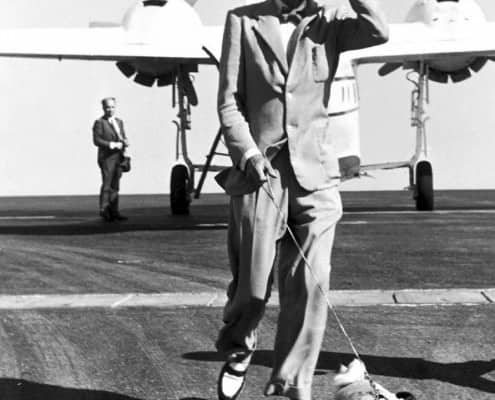 Duke of Windsor in suit with bow tie, hat and two tone Penny Loafers