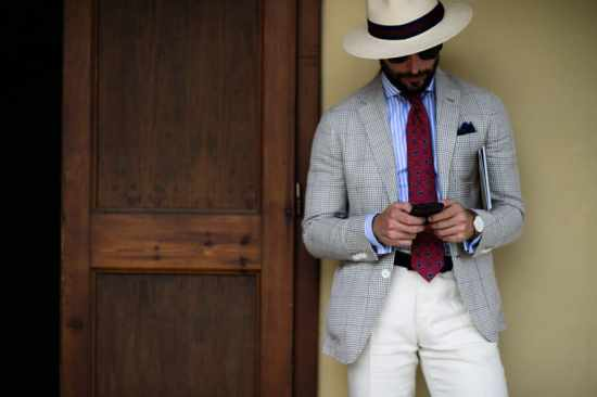 Panama Hat, stripes shirt, checked sport coat, off white slacks and printed red Madder Tie