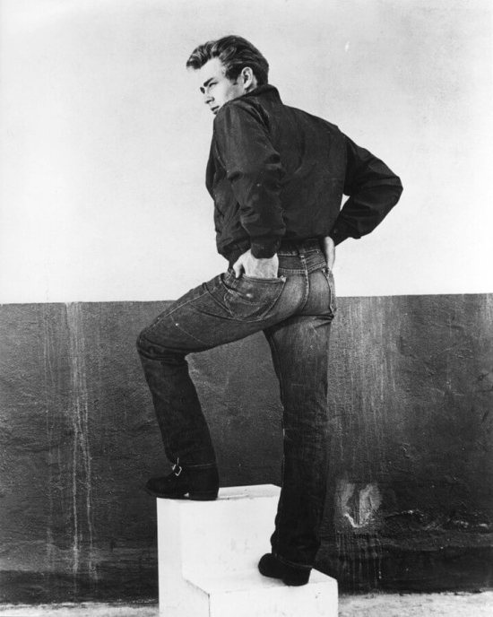 James Dean shows off the fit of his blue jeans in Rebel Without a Cause.