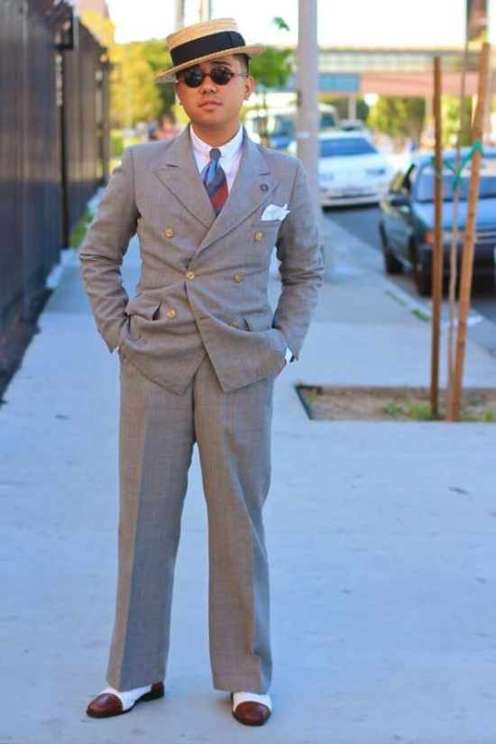 Ethan wearing is beloved spectators and a DB suit with faint mini windowpane paired with a boater hat