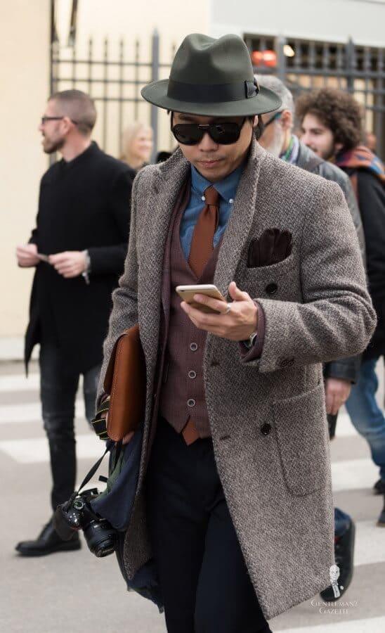 Denim Shirt with Brown vest, simplar sport coat and light brown overcoat and light brown grenadine tie