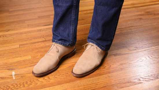 Allen Edmonds Chukka boots paired with dark denim jeans