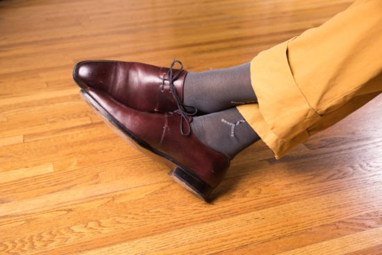 Oxblood derby shoes with Grey Socks with Light Grey and Black Clocks in Cotton - Fort Belvedere with mustard yellow trousers
