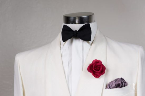 Off-white Dinner jacket with Fort Belvedere red spray rose boutonniere and Black Bow Tie in Silk Barathea and Burgundy glen plaid silk pocket square