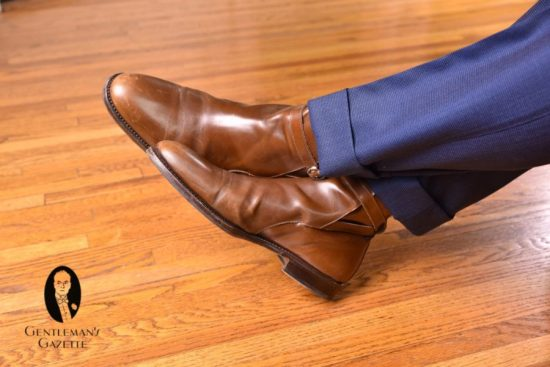 brown jodhpur boots with navy blue trousers