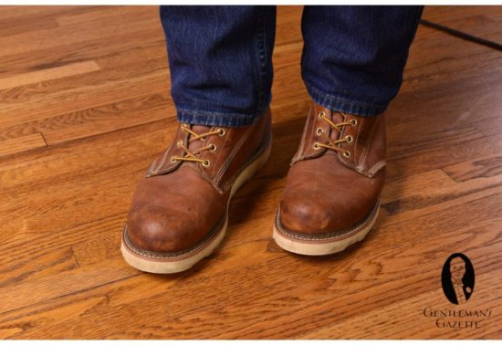 Brown work boots with denim jeans