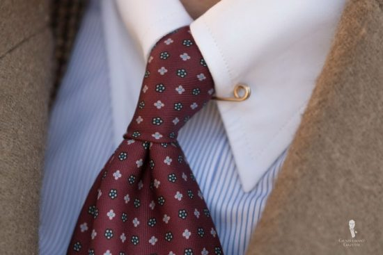 Wearing a collar pin is something you should consider if you want the classic look