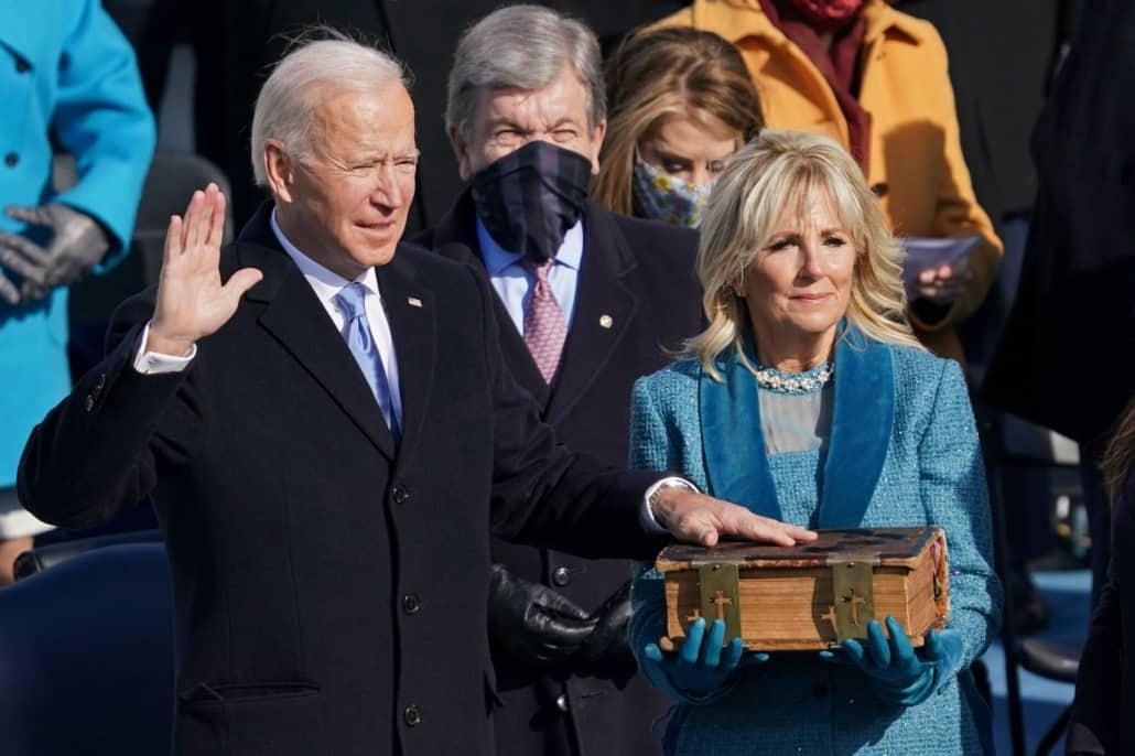 Joe Biden wearing a navy single breasted overcoat