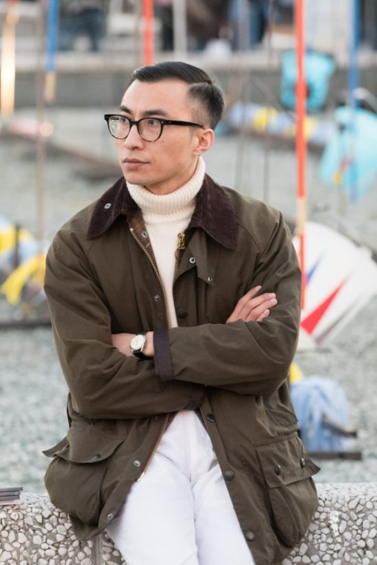 Wax jacket with turtleneck and off white sweater with white pants