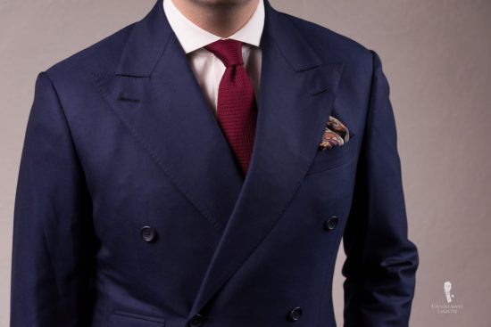 Navy suit with burgundy grenadine tie