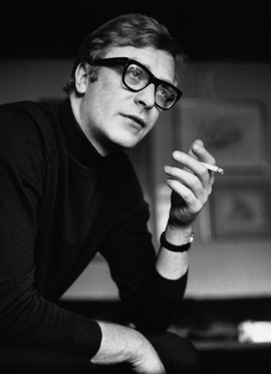 Michael Caine wearing statement rectangular glasses in the 60s