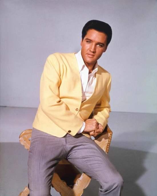 Elvis Presley wearing yellow jacket and gray pants