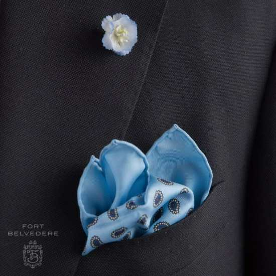 Light blue delphinium and pocket square on a navy blazer