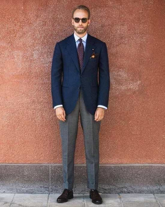 Andreas Weinås doesn't look like a security guard in this combination of navy and gray.