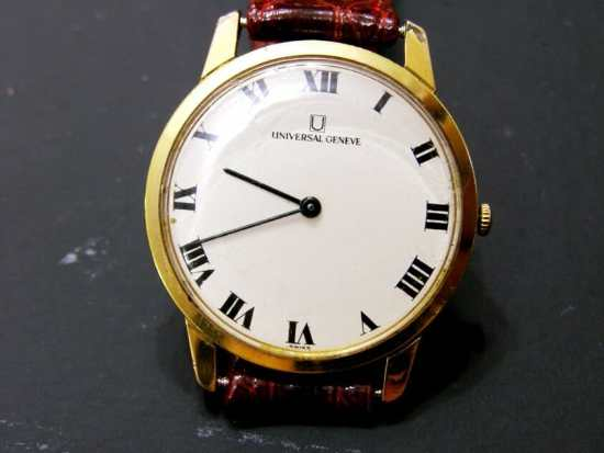 A gold-cased Universal Genève watch